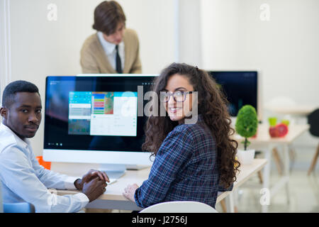Multiethnic group of happy business people working with laptop computer in office Stock Photo
