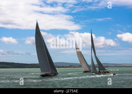 J-Class yachts 'Rainbow' (H2), 'Lionheart' (H1) and 'Velsheda' (JK7) maneouvring  just before the start of Race - Stock Photo