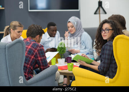 Shot of a group of young business professionals having a meeting. - Stock Photo