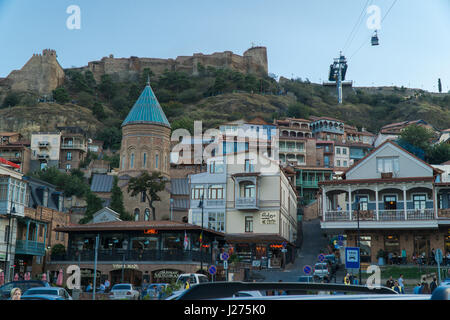 TBILISI, GEORGIA-SEP 25, 2016: Building on Gorgasali square in the old town overlooking the Narikala fortress. - Stock Photo