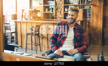 Young Man in Barbershop Hair Care Service Concept - Stock Photo