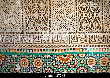 Berber Mocarabe Honeycomb work plaster decorations and Berber design tiles of the Mauseleum of Moulay Ismaïl Ibn - Stock Photo