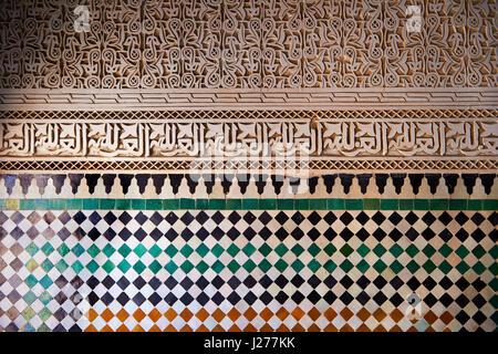 Berber Mocarabe Honeycomb work plaster decorations and Berber design tiles of the 17th century Berber Pavillion - Stock Photo