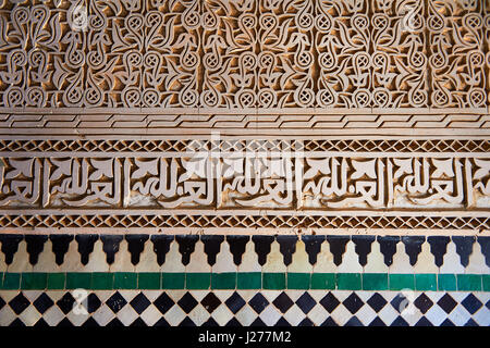 Berber Mocarabe Honeycomb work plaster decorations and Berber design tiles of the 17th century Berber Pavillion - Stock Photo