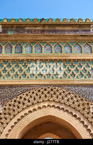 Zellij mosaics and arabesque Moorish plasterwork of the Bab Mansour gate. Named after the architect, El-Mansour, - Stock Photo