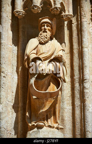 Christ's Entry into Jerusalem by Lope Marin in 1548 on the Gothic Puerta de Campanilla entrance door of the Cathedral - Stock Photo