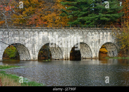 Wachusett Aqueduct Bridge on the Assabet River, Northborough, Massachusetts, in Autumn - Stock Photo