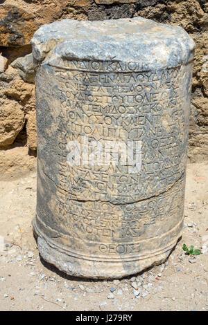 Ancient Greek writing on stone pillar, Lindos, Rhodes, Rodos, Greece - Stock Photo
