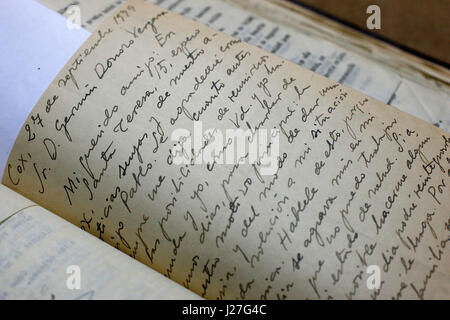 Spanish historian Mario Amoros reviews one of the eleven hand-written letters that the Spanish poet Miguel Hernandez - Stock Photo