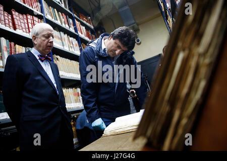 Spanish historian Mario Amoros (R), next to Spain's Ambassador to Chile Carlos Robles Fraga (L), reviews one of - Stock Photo