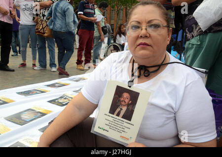 Medellin, Colombia. 06th Mar, 2017. Luz Mary Velasquez Carmona shows a shrink-wrapped picture of her husband Julian - Stock Photo