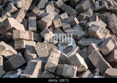 A big heap of heavy paving stones - Stock Photo