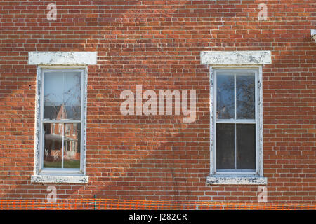 Brick wall with old style windows. - Stock Photo