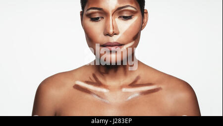 Close up of professional contour and highlight makeup. Contouring face makeup applying sample. - Stock Photo