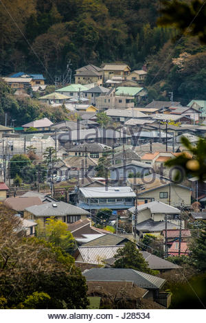 Houses in valley seen from the Daibutsu Hiking Trail, Kamakura, Kanagawa Prefecture, Honshu, Japan - Stock Photo