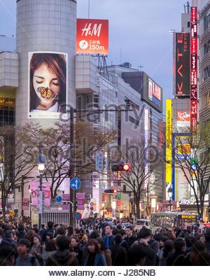 The world famous pedestrian scramble in front of Shibuya Station at dusk, Shibuya, Tokyo, Honshu, Japan - Stock Photo