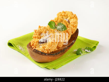 Almond crumb cookies in olive wood boat-shaped bowl - Stock Photo