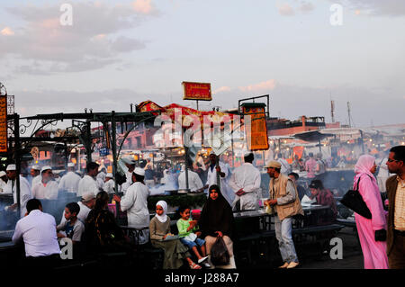 Food stalls in the colorful night market in the Djema el fna sq. in Marrakesh, Morocco. - Stock Photo