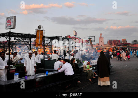 DFood stalls in the colorful night market in the Djema el fna sq. in Marrakesh, Morocco. - Stock Photo