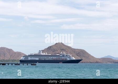 The cruise ship Volendam belonging to tht Holland America line anchored off the island of Komodo, Indonesia - Stock Photo
