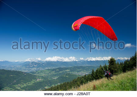 France, Alps, paragliding takeoff at the Collet d'Allevard. Valley of the Clue de Chambery in the distance - Stock Photo