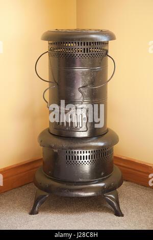Antique metal heater, stove. - Stock Photo