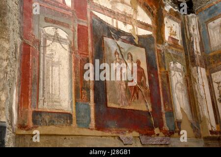 Frescoes fresco on the walls of College of The Augustales Herculaneum ancient Roman city destroyed by volcanic  - Stock Photo