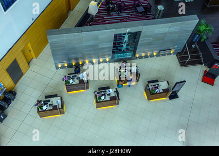 Reception desk area at Radisson Blu Airport hotel at London Stansted airport seen from above - Stock Photo