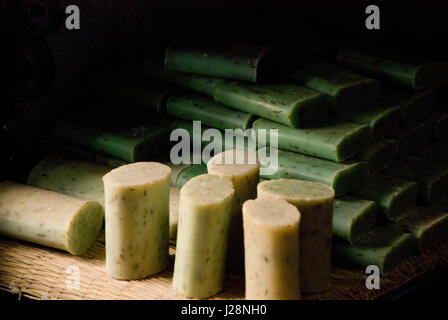 Hand made natural soaps pile up in a shop. Chefchaouen Morocco - Stock Photo