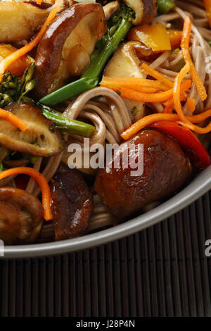 chinese noodles with mushrooms in bowl, food closeup - Stock Photo