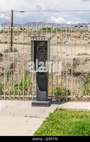 It's a sign of the times...the payphone has been taken out leaving only the empty booth. - Stock Photo