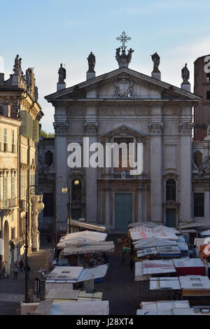 Mantua Cathedral and Piazza Sordello on a market day in the early morning light seen from Hotel dei Gonzaga - Stock Photo