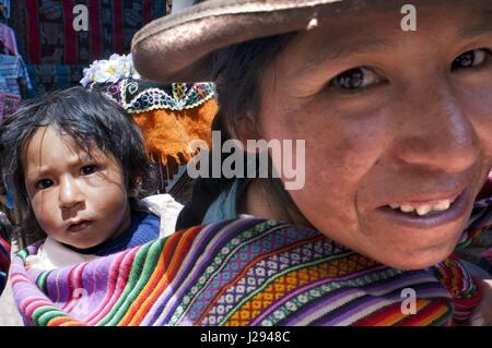 Sacred Valley, Pisac, Peru. A woman dressed in a traditional costume in Pisac Sunday market day. Pisac. Sacred Valley. - Stock Photo