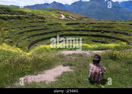 A pastor in the archaeological site of Moray in the Sacred Valley near Cuzco. Moray - is the name of the Incan ruins - Stock Photo