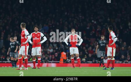 Arsenal players look dejected after Southampton's second goal during the EFL Cup Quater-final match between Arsenal - Stock Photo