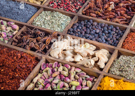 wooden box with spices and herbs - Stock Photo