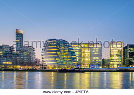 United Kingdom, England, London. London City Hall designed by architecht Norman Foster, and modern buildings in the Borough of Southwark at dawn.