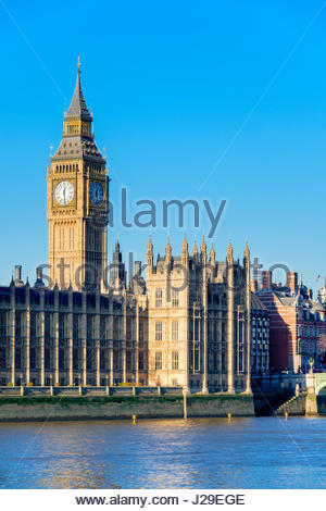 United Kingdom, England, London. The clock tower of Big Ben (Elizabeth Tower) above Palace of Westminster, the houses - Stock Photo