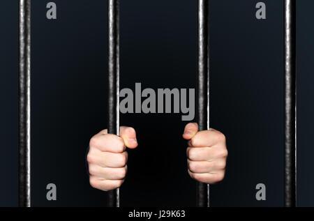 Hands holding Jail Bars, 3d illustration - Stock Photo