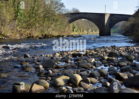 the A67 road bridge at Barnard Castle seen from the riverbank upstream - Stock Photo