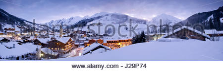 France, Eastern France, mountain range of the Aravis, La Clusaz, panorama of the village and the mountain range - Stock Photo