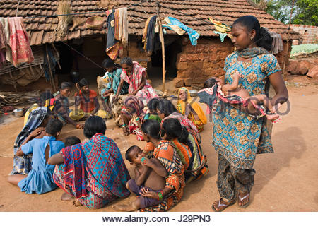India, Orissa, Sadaibarini, untouchable village specialized in the foundry of objects, group of women playing - Stock Photo
