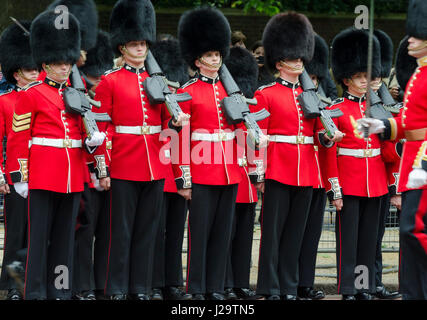 LONDON - JUNE 13, 2015: Members of the Queen's Royal Guard stand at attention in a Trooping of the Colour procession - Stock Photo