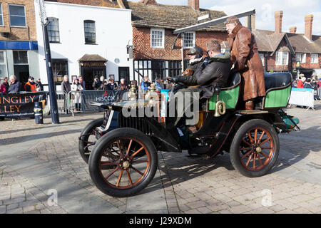 Mr Cliff Jowsey driving his 1902 Renault  with his dog on his lap, during the 2016 London to Brighton Veteran Car - Stock Photo