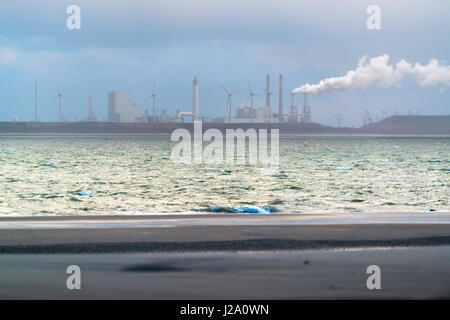 Industry in the port of Rotterdam as seen from the island of goeree - Stock Photo