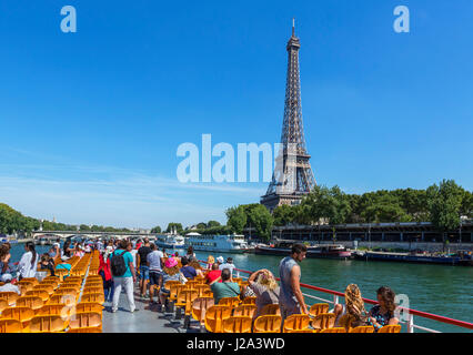 View of the Eiffel Tower from a Bateau Mouche on the River Seine, Paris, France - Stock Photo