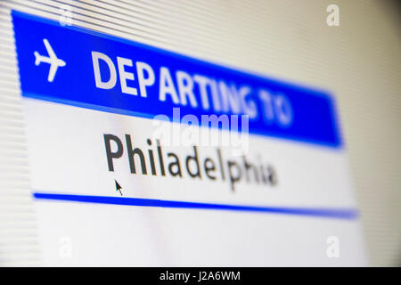 Computer screen close-up of status of flight departing to Philadelphia, Pennsylvania, USA - Stock Photo