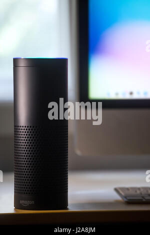 Amazon echo alexa voice recognition technology, computer in background - Stock Photo