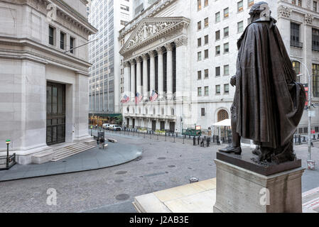 A view of Wall Street from the steps of the Federal Hall on a sunny day in New York, NY. - Stock Photo