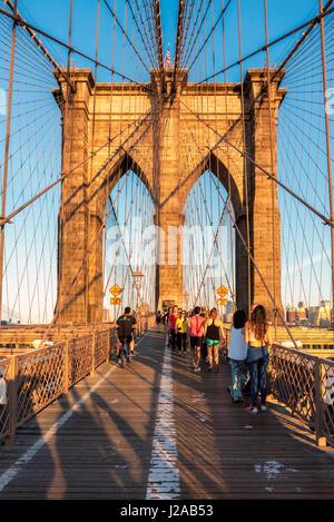 The Brooklyn Bridge at sunset in New York, NY. - Stock Photo
